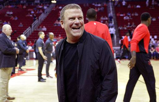 FILE - In this Oct. 13, 2017, file photo, new Houston Rockets owner Tilman Fertitta reacts before an NBA preseason basketball game against the San Antonio Spurs in Houston. Fertitta is interested in bringing an NHL hockey team to Houston, a possibility that did not exist under the NBA team's previous regime. (AP Photo/Michael Wyke, File)