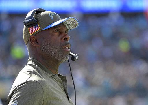 FILE- This Nov. 12, 2017, file photo shows Los Angeles Chargers head coach Anthony Lynn watching his team against the Jacksonville Jaguars during the first half of an NFL football game, in Jacksonville, Fla. Lynn was a Bills assistant for the past two years, and he made his NFL head coaching debut last winter for the final game of the Bills' 17th consecutive non-playoff season. (AP Photo/Phelan M. Ebenhack, File)
