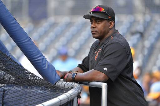 FILE - In this Aug. 28, 2017, file photo, San Francisco Giants hitting coach Hensley Meulens takes in batting practice before the baseball game against the San Diego Padres in San Diego. Meulens is the third candidate to interview for New York Yankees manager after Rob Thomson and Eric Wedge. A former outfielder who spent five of his seven major league seasons with the Yankees, the 50-year-old has been a coach with the San Francisco Giants for the last 8 seasons and was shifted last month from hitting coach to bench coach. (AP Photo/Orlando Ramirez, File)