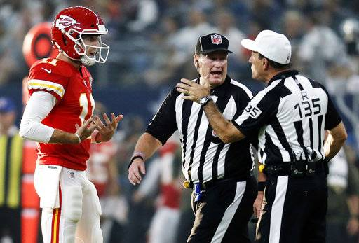 FILE - In this Sunday, Nov. 5, 2017, file photo, Kansas City Chiefs quarterback Alex Smith (11) argues a call with side judge Laird Hayes (125) and referee Pete Morelli (135) during an NFL football game against the Dallas Cowboys in Arlington, Texas. The Chiefs hope a week off can serve as a reset to their season. They began 5-0 before losing three of their last four, and quarterback Alex Smith even threw an interception in a loss to Dallas just before the bye.
