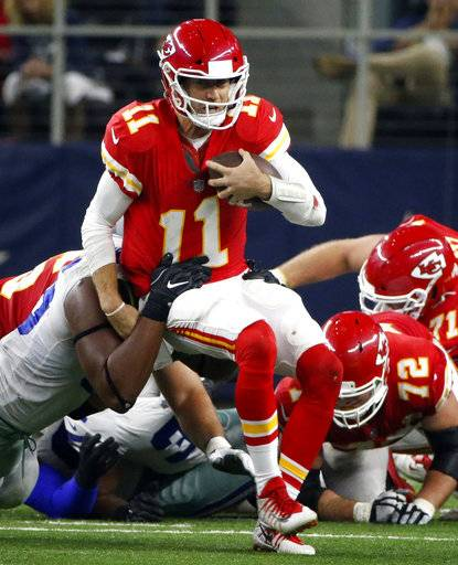 FILE - In this Sunday, Nov. 5, 2017, file photo, Dallas Cowboys defensive tackle David Irving, left, sacks Kansas City Chiefs quarterback Alex Smith (11) in the second half of an NFL football game in Arlington, Texas. The Chiefs hope a week off can serve as a reset to their season. They began 5-0 before losing three of their last four, and quarterback Alex Smith even threw an interception in a loss to Dallas just before the bye.