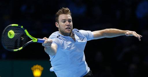 Jack Sock of the United States plays a return to Alexander Zverev of Germany during their men's singles tennis match at the ATP World Finals at the O2 Arena in London, Thursday, Nov. 16, 2017. (AP Photo/Alastair Grant)