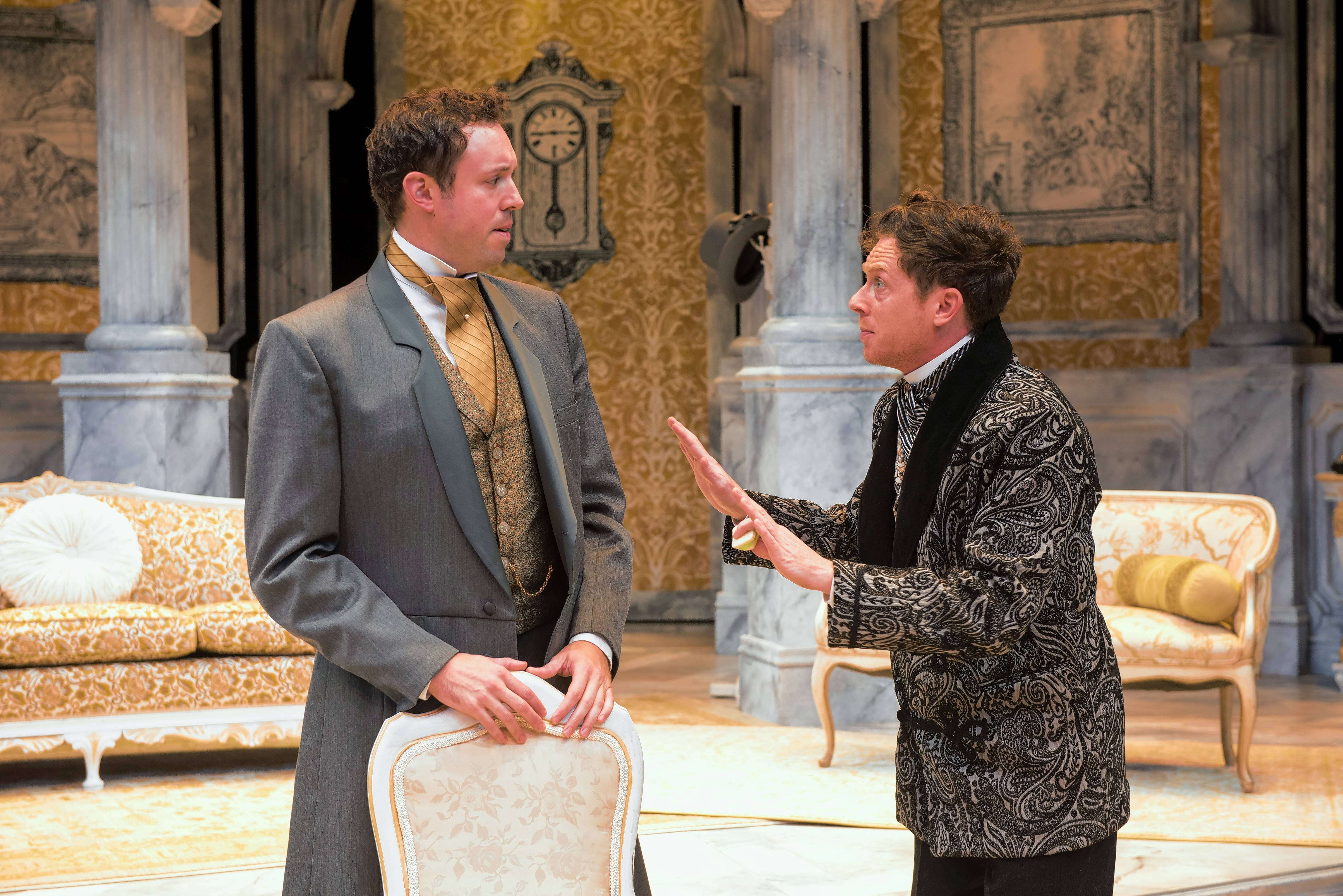 "John Worthing (Alex Goodrich) and his society friend, Algernon Moncrieff (Steve Haggard), share their schemes of creating false relations to cover up bad behavior in Oscar Wilde's 1895 comedy ""The Importance of Being Earnest"" at Writers Theatre in Glencoe."