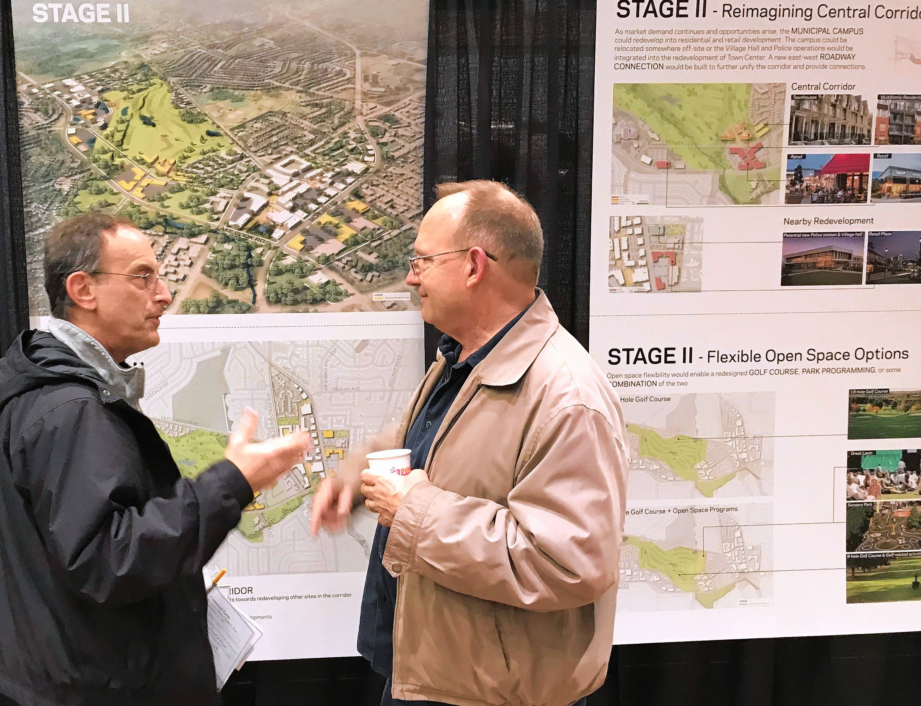 Jerry Meyerhoff, left, and Skip Glatt discuss the latest vision for the Lake-Cook Road corridor from Buffalo Grove planners and consultants, which was unveiled at a meeting Thursday.