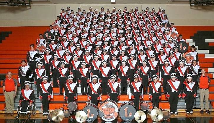 Members of Libertyville High School's Wildcat marching band will perform in Chicago on Saturday and in London on New Year's Day.