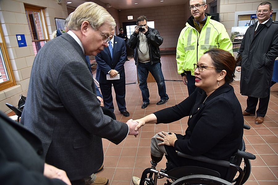 Sen. Tammy Duckworth greets Metra Chairman Norman Carlson at a news conference Friday at the National Street Station in Elgin. Metra officials announced their intention to break ground on the replacement of an 1881 train bridge over the Fox River. Duckworth, a Hoffman Estates Democrat, helped secure the funds for the project.