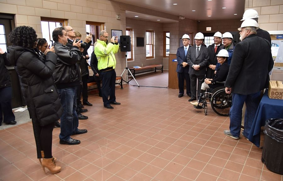 Metra officials, along with Sen. Tammy Duckworth and Elgin Mayor David Kaptain, have their picture taken at a Friday news conference at the National Street Station in Elgin.