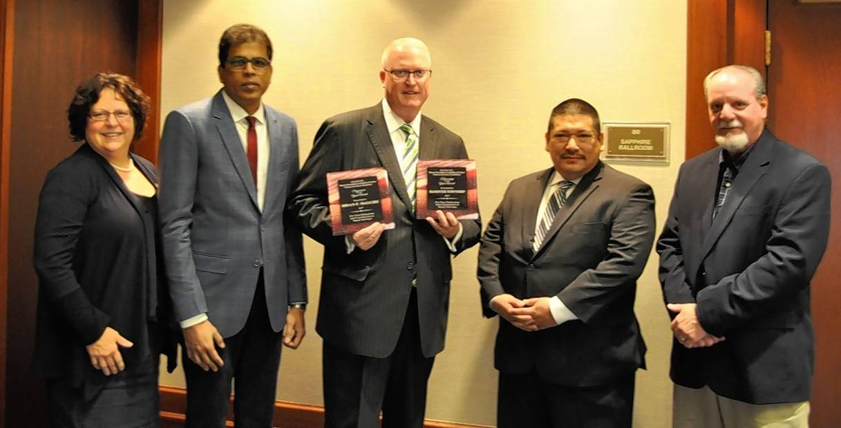 Hanover Township Clerk Katy Dolan Baumer, Trustee Khaja Moinuddin, Supervisor Brian McGuire with Trustees Craig Essick and Eugene Martinez with the township's awards at the Township Officials of Illinois Educational Conference in Springfield.