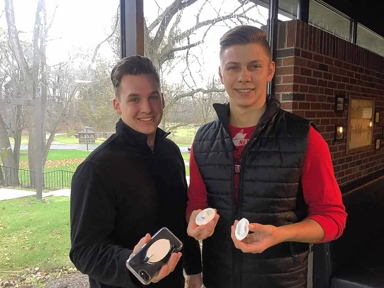 "Judson University seniors Ryan Faulkner, left, and Creighton North won the $1,000 first-place prize and the $100 Fan Favorite prize for their ""Earbuddi"" idea in the ""Shark Tank"" business pitch contest Thursday."