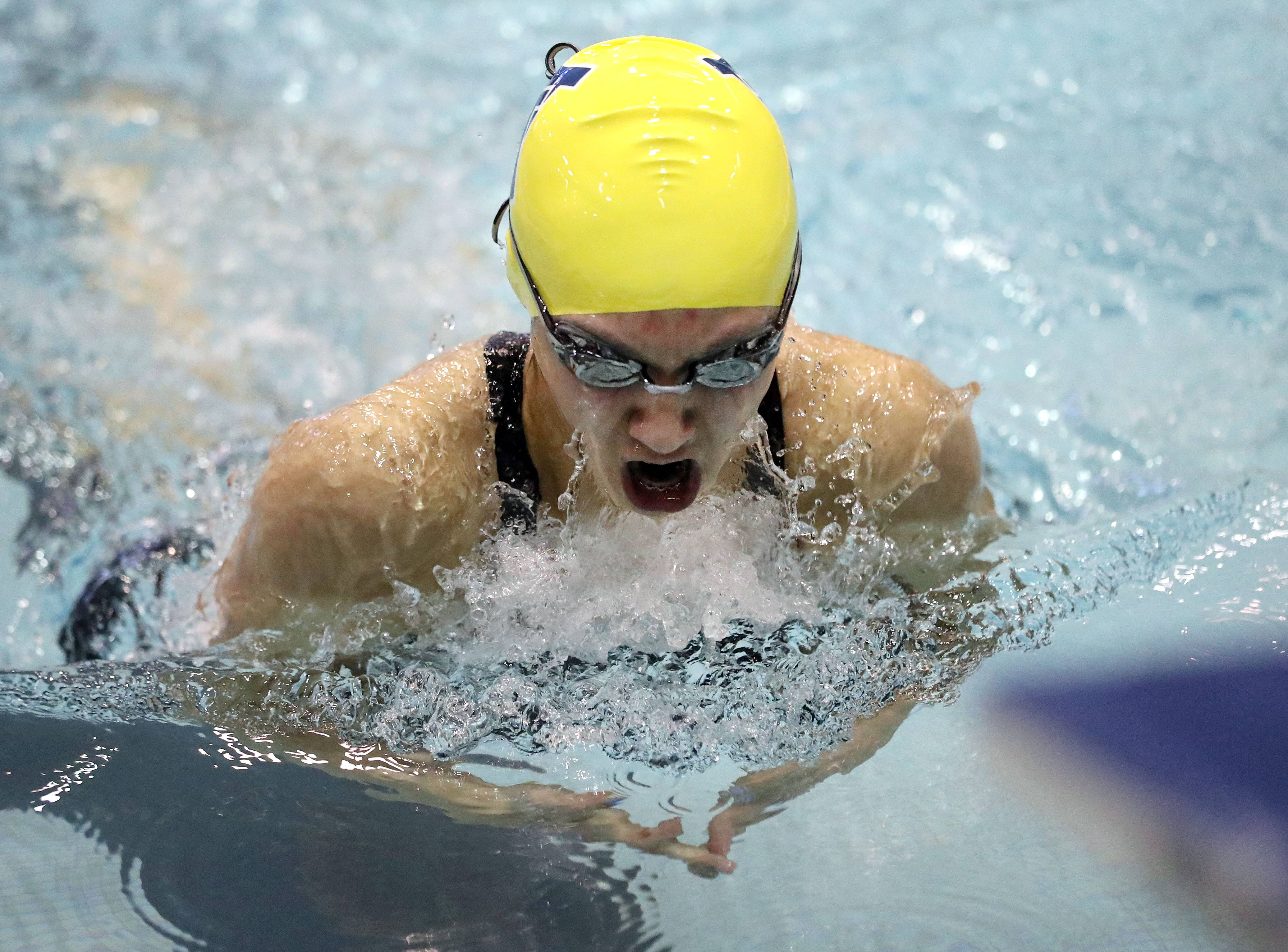 Neuqua Valley's Maxine Parkinson swims in the 100-breastroke during the girls state swimming preliminaries Friday at New Trier High School in Winnetka.