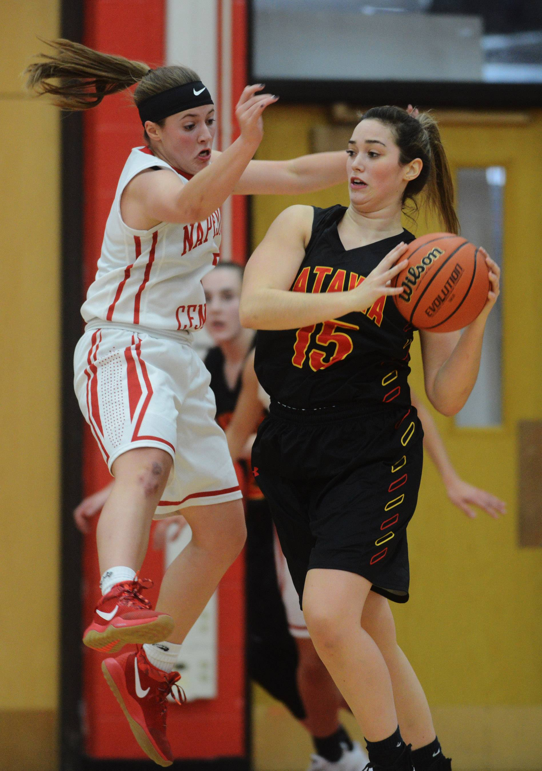 Naperville Central's Gabi Melby, left, closely guards Batavia's Ava Sergio during Friday's game in Naperville.