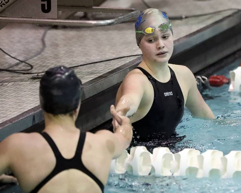 Vernon Hills' Casey Craffey, right, shakes hands with Stevenson's Iza Pelka  after their