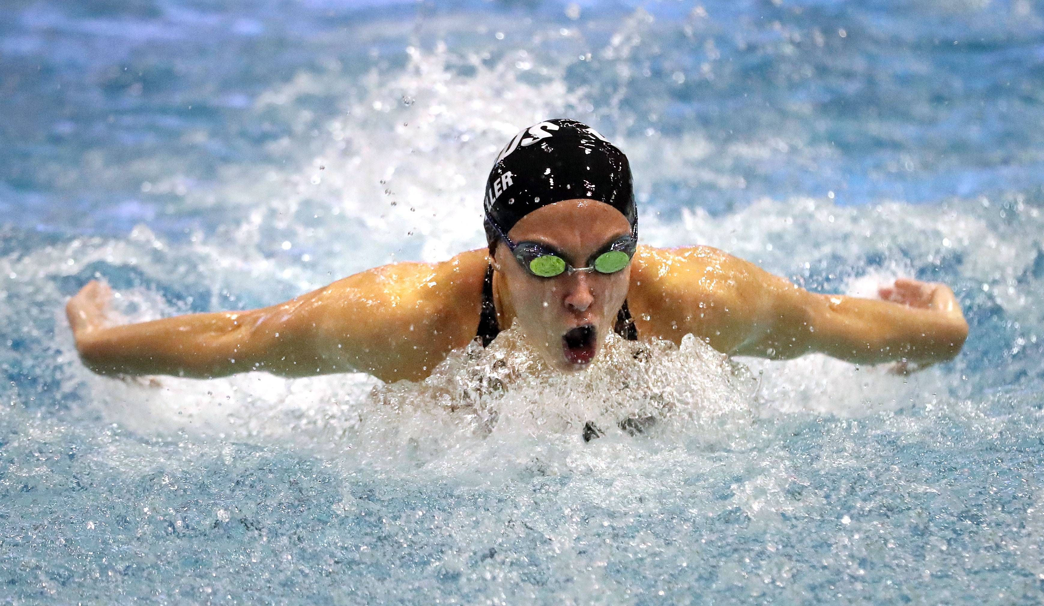 Rosary's Kathryn Mueller swims in the 100-yard butterfly.