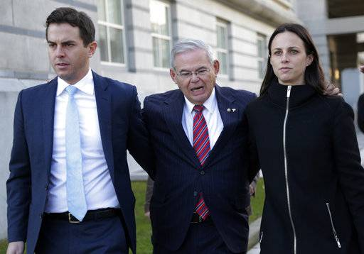 Democratic Sen. Bob Menendez, center, and his children, Robert and Alicia, leave the federal courthouse in Newark, N.J., Thursday, Nov. 16, 2017. The federal bribery trial of Menendez ended in a mistrial Thursday when the jury said it was hopelessly deadlocked on all charges against the New Jersey politician and a wealthy donor. (AP Photo/Seth Wenig)
