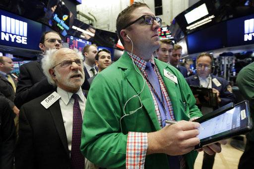 Traders Peter Tuchman, left, and Ryan Falvey work on the floor of the New York Stock Exchange, Friday, Nov. 17, 2017. U.S. stocks are dipping Friday morning, a day after the market made its biggest gain in two months. (AP Photo/Richard Drew)