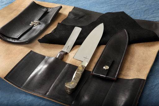 The Town Cutler Chef Kit, that consists of their Black Leather 5-Slot Knife Wrap, an 8.5-inch AEB-L Stainless Steel Chef Knife with Buckeye Burl Handle and leather scabbard, right, and a 4-inch Charcoal Palette Knife, is shown in this photograph in New York, Tuesday, Oct. 31, 2017. (AP Photo/Richard Drew)