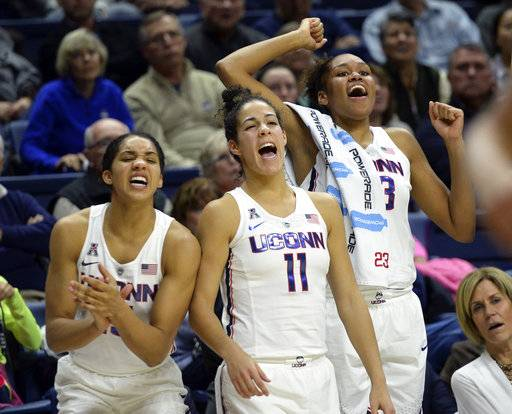 Connecticut's Gabby Williams (15), Kia Nurse (11) and Azura Stevens (23) react at the end of an NCAA college basketball game against California, Friday, Nov. 17, 2017, in Storrs, Conn. (AP Photo/Stephen Dunn)