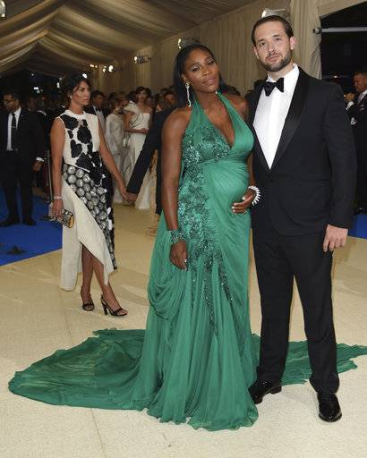 FILE - In this Monday, May 1, 2017 file photo, Serena Williams, left, and Alexis Ohanian attend The Metropolitan Museum of Art's Costume Institute benefit gala celebrating the opening of the Rei Kawakubo/Comme des Garçons: Art of the In-Between exhibition in New York. The game is love for tennis star Williams and her new husband, Reddit co-founder Ohanian. The couple got married at the Contemporary Arts Center in New Orleans, according to a story and photos posted on Vogue's website on Friday night, Nov. 17, 2017. (Photo by Evan Agostini/Invision/AP, File)