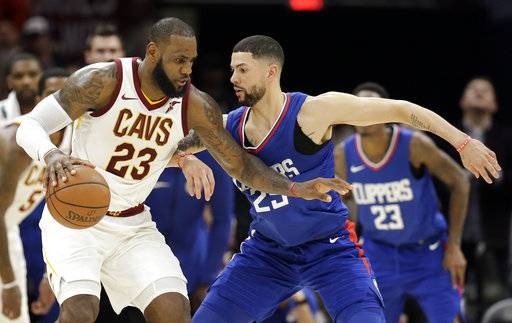 Cleveland Cavaliers' LeBron James (23) works against Los Angeles Clippers' Austin Rivers (25) during the second half of an NBA basketball game, Friday, Nov. 17, 2017, in Cleveland. The Cavaliers won 118-113 in overtime. (AP Photo/Tony Dejak)