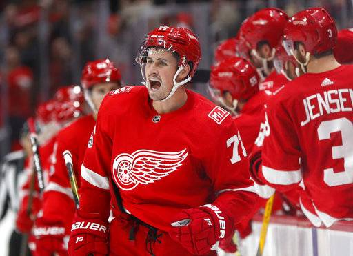 Detroit Red Wings center Dylan Larkin celebrates his goal against the Buffalo Sabres during the third period of an NHL hockey game Friday, Nov. 17, 2017, in Detroit. Detroit won 3-1. (AP Photo/Paul Sancya)