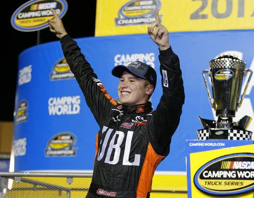 Christopher Bell celebrates in Victory Lane after winning the NASCAR Truck Series auto racing season championship at Homestead-Miami Speedway in Homestead, Fla., Friday, Nov. 17, 2017. (AP Photo/Terry Renna)