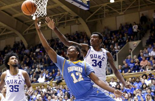 Duke's Wendell Carter Jr. (34) guards Southern's Jared Sam (12) during the second half of an NCAA college basketball game in Durham, N.C., Friday, Nov. 17, 2017. Duke won 78-61. (AP Photo/Gerry Broome)