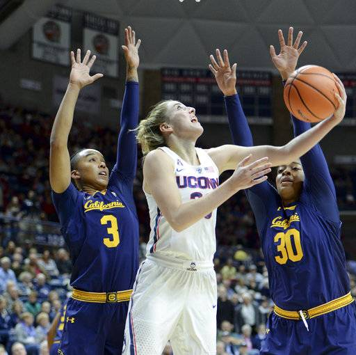 Connecticut's Katie Lou Samuelson (33) goes up for two points against California's Mikayla Cowling (3) and CJ West (30) during the first half of an NCAA college basketball game Friday, Nov. 17, 2017, in Storrs, Conn. (AP Photo/Stephen Dunn)