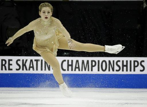 FILE - In this Jan. 21, 2017, file photo, Gracie Gold performs during the women's free skate at the U.S. Figure Skating Championships in Kansas City, Mo. Gold has withdrawn from the national championships while she continues to seek treatment for depression, anxiety and an eating disorder. Gold announced last month that she was withdrawing from her Grand Prix assignments, and her decision to skip the nationals in January ends any chance of her competing at next year's Winter Olympics. (AP Photo/Charlie Riedel, File)