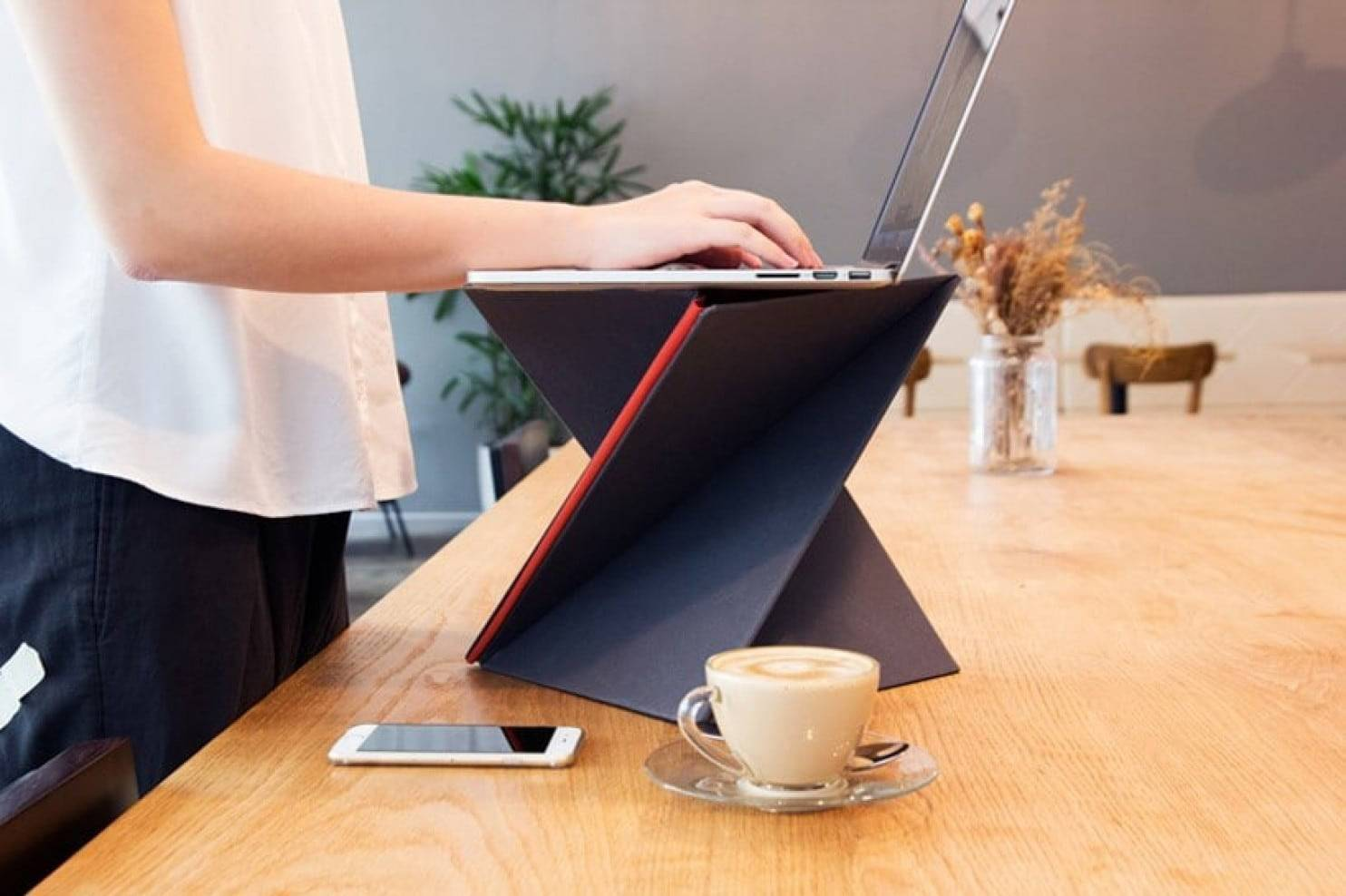 Because sitting all day isn't good for you, stand up and work with Levit8's attractive, portable computer stand.
