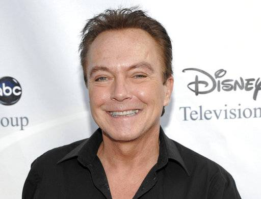 "FILE - This Aug. 8, 2009 file photo shows actor-singer David Cassidy arrives at the ABC Disney Summer press tour party in Pasadena, Calif. Cassidy has been hospitalized in Florida. His representative tells The Associated Press on Saturday, Nov. 18, 2017, that Cassidy is ""now conscious� and ""surrounded by family.� The rep adds that Cassidy was in pain and taken to the hospital on Wednesday. No additional details were provided. (AP Photo/Dan Steinberg, File)"