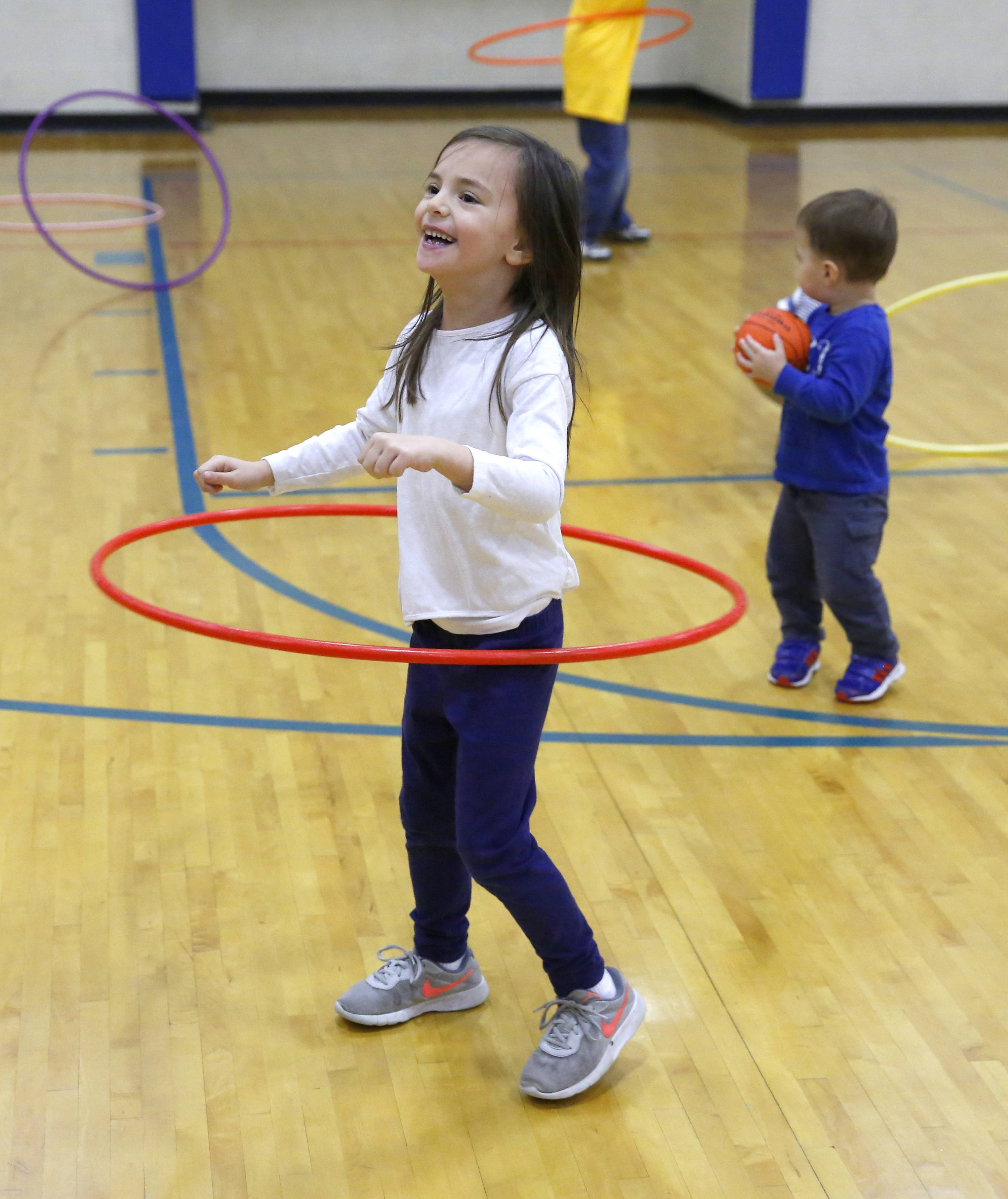 Lana Djuric, 6, of Wood Dale practices with her Hula Hoop as the Wood Dale Park District celebrates its 50th anniversary at the Wood Dale Park District Recreation Complex.