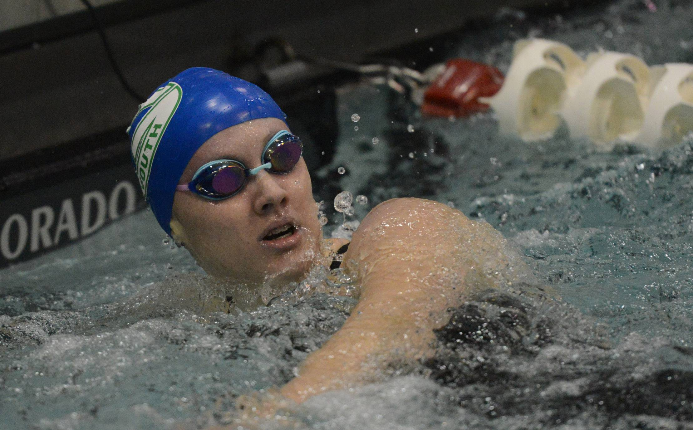 Kate Morris of Glenbard West-South co-op views her time following the 100-yard freestyle during the girls swimming and diving state finals at New Trier High School in Winnetka Saturday.
