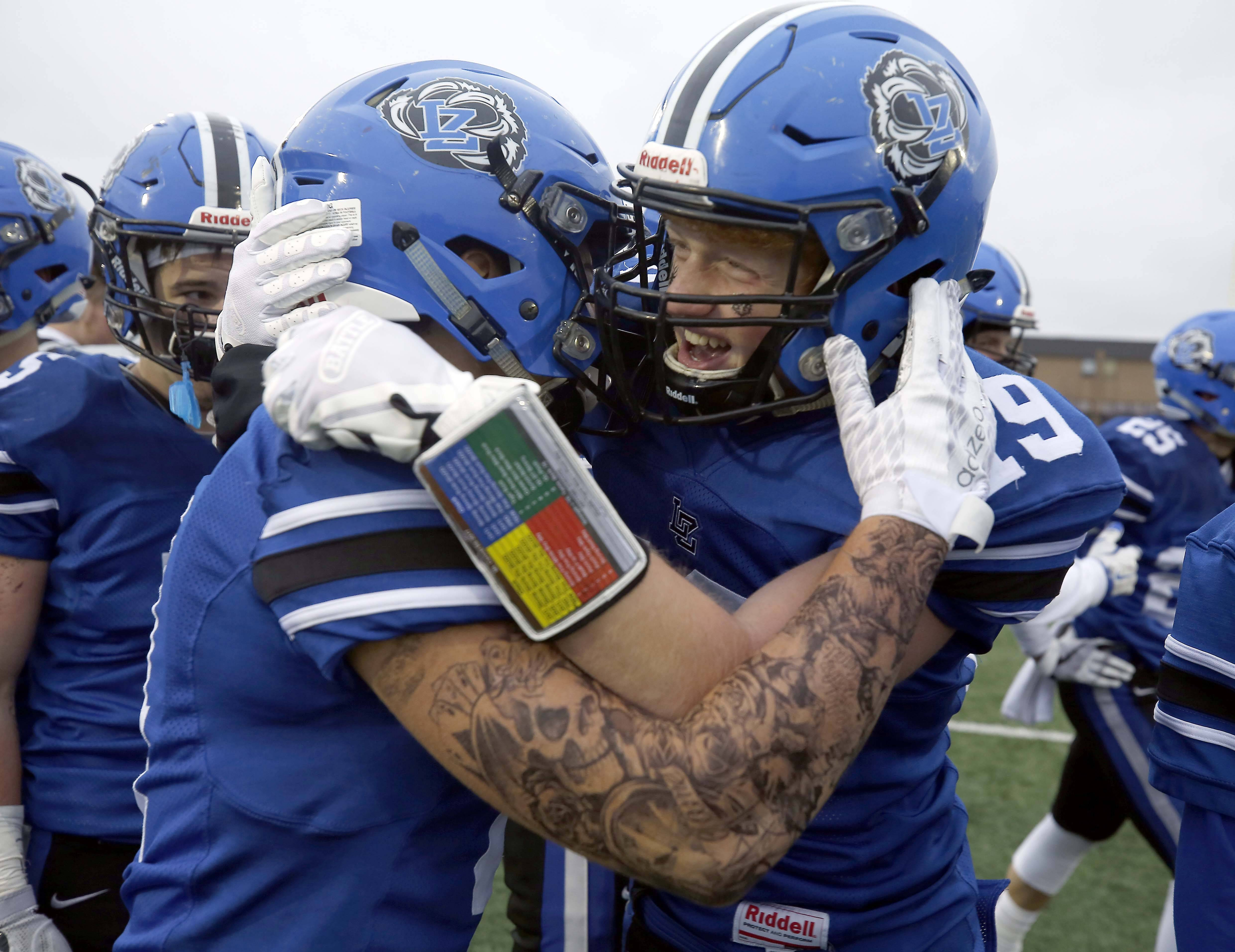 Lake Zurich players celebrate at the end of their win against Mt. Carmel in the Class 7A semifinals on Saturday in Lake Zurich.