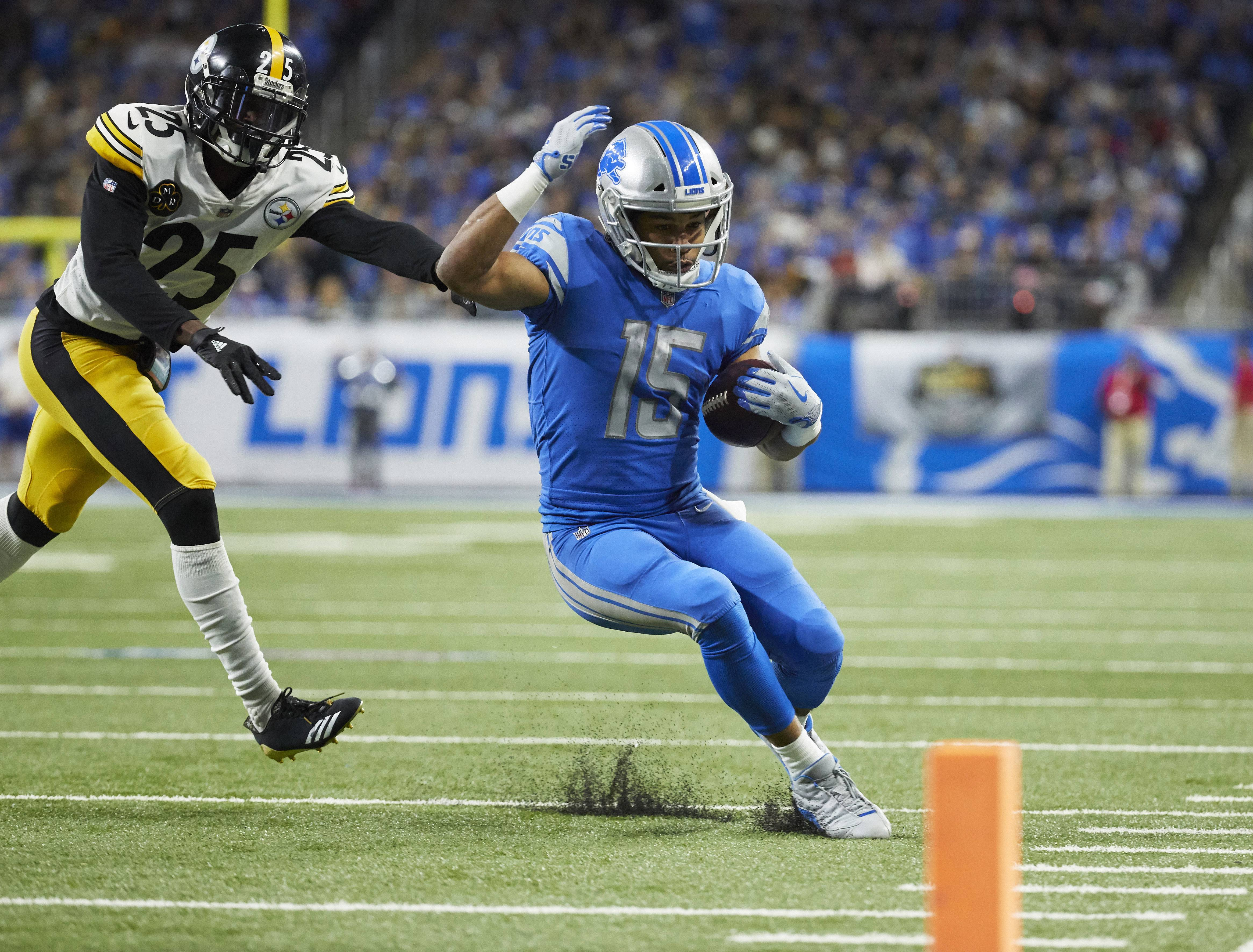 FILE - In this Oct. 29, 2017, file photo, Detroit Lions wide receiver Golden Tate (15) runs the ball while chased by Pittsburgh Steelers cornerback Artie Burns (25) during an NFL football game in Detroit. Tate remains Detroit's top receiver, with 56 catches for 659 yards on the season, and it now looks like he'll have plenty of help down the stretch. (AP Photo/Rick Osentoski, File)