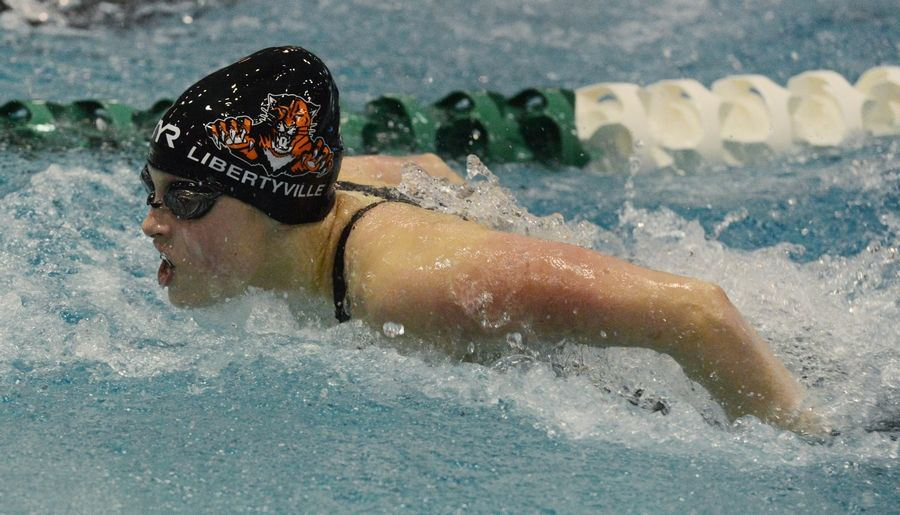 Libertyville's Emma Gleason swims the 100-yard butterfly in the consolation final of the girls swimming and diving state finals at New Trier High School in Winnetka on Saturday.