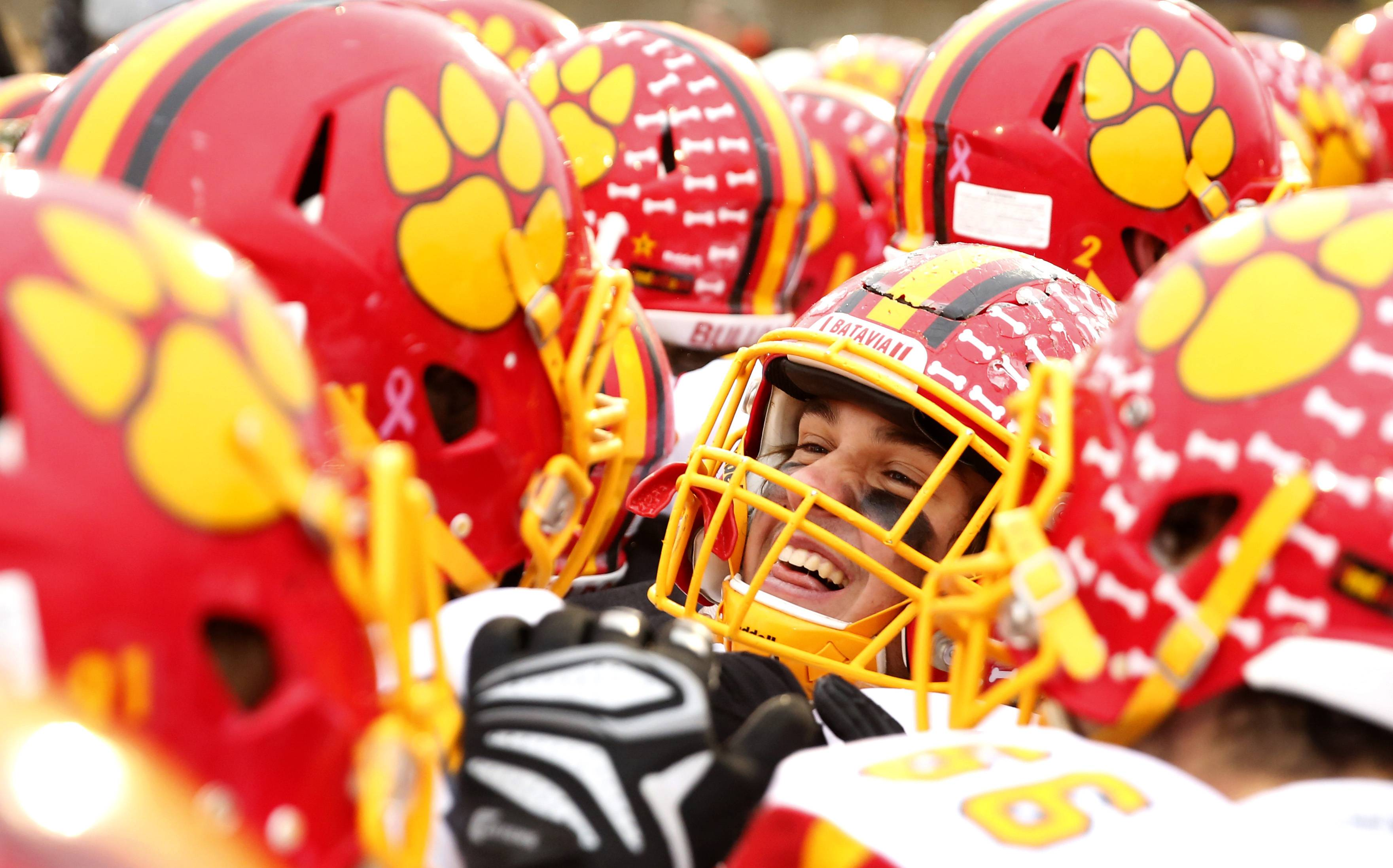 Batavia's players celebrate their 23-13 win over Benet Academy in the Class 7A football semifinals at Benedictine University in Lisle on Saturday.