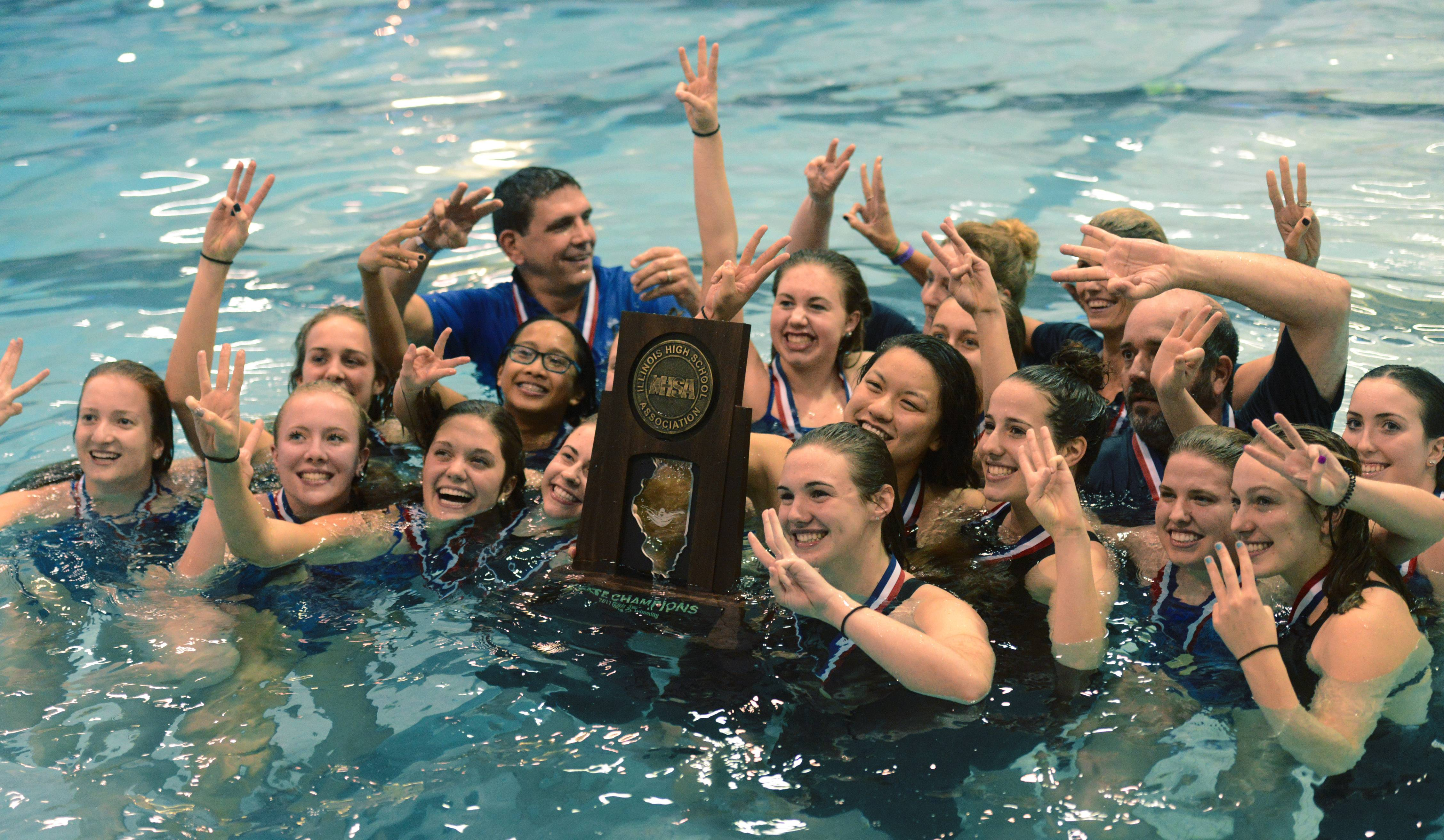 Rosary celebrates its state championship during the girls swimming and diving state finals at New Trier High School in Winnetka Saturday.