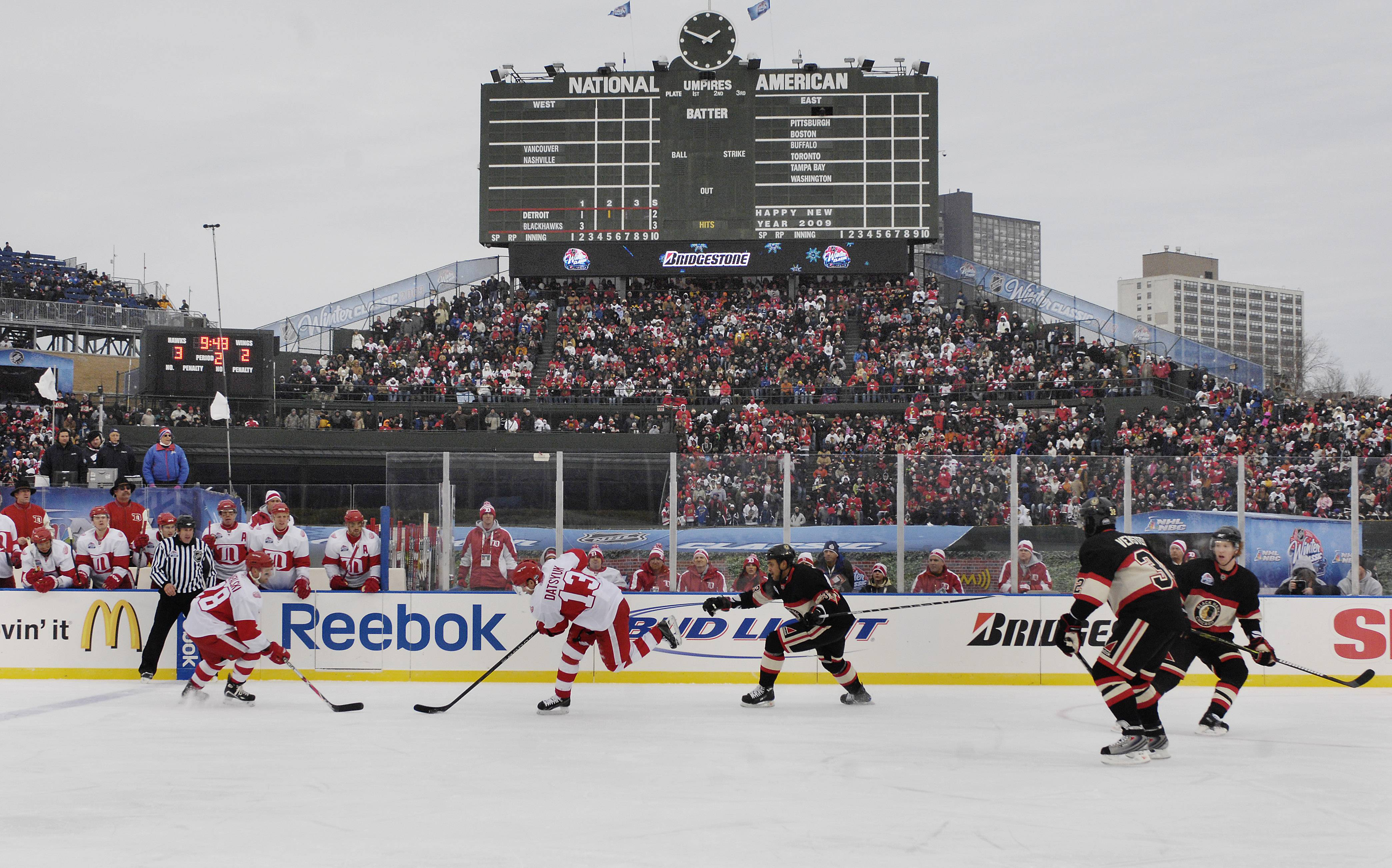 MARK WELSH/mwelsh@dailyherald.com, January 2009 The Chicago Blackhawks and Detroit Redwings batlte on the ice at Wrigley Field for the 2009 Winter Classic. The NHL announced Saturday that the Chicago Blackhawks will take on the Boston Bruins in the 2019 Winter Classic at Notre Dame Stadium in Jan. 1, 2019. It will be the fifth time the Hawks have played outside since 2009.