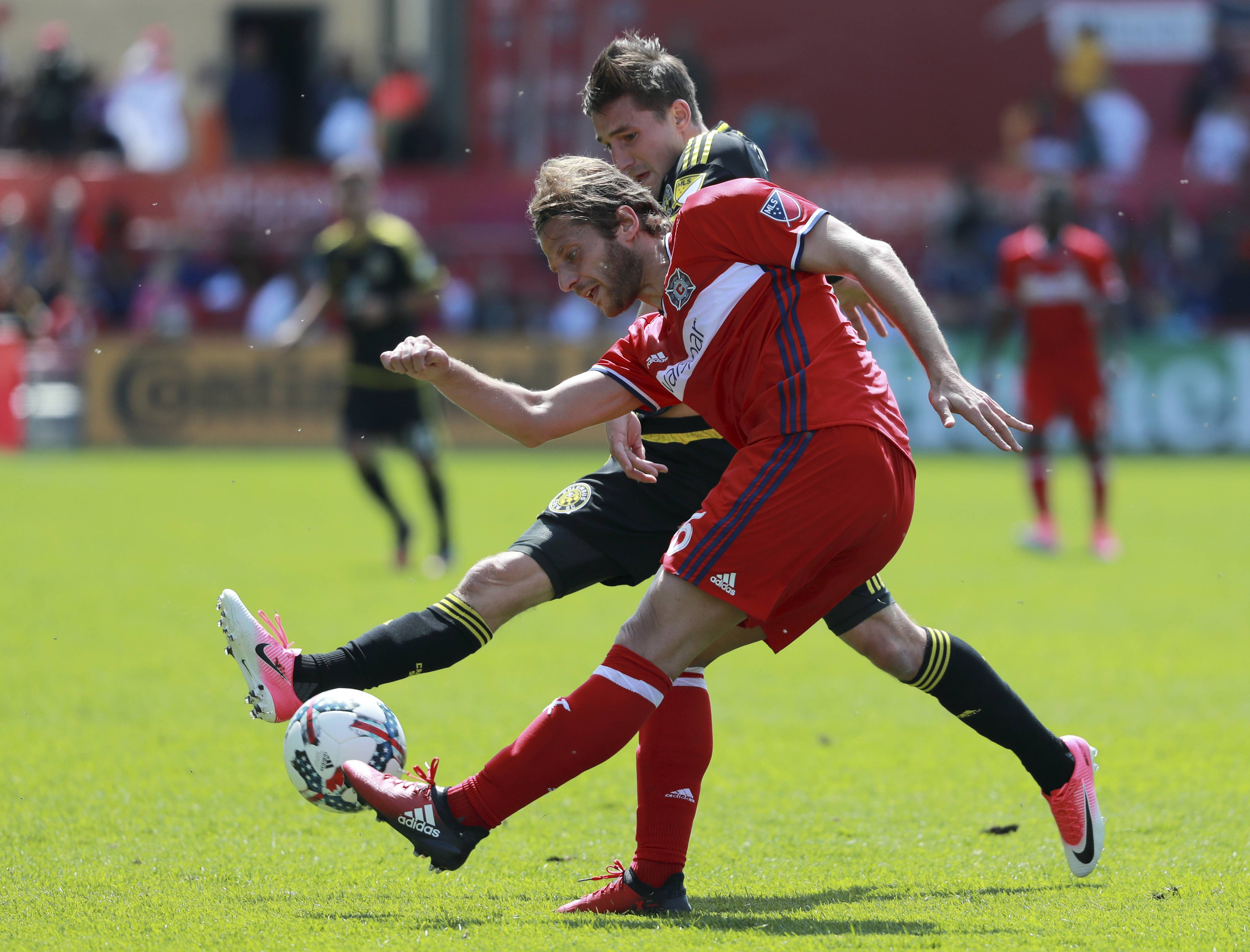 Chicago Fire defender Joao Meira (66) and Columbus Crew midfielder Ethan Finlay (13) battle for the ball during the first half of an MLS soccer match, Saturday, April 8, 2017, in Chicago.