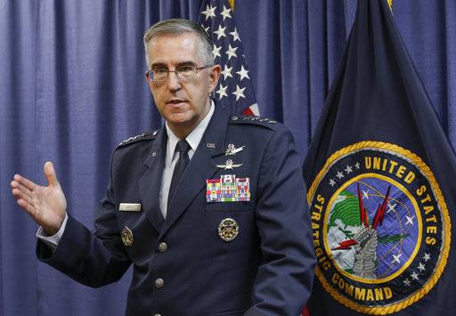 FILE - In this Thursday, Nov. 3, 2016 file photo, Air Force Gen. John Hyten, the incoming commander of the United States Strategic Command, speaks to reporters following a change of command ceremony at Offutt Air Force Base in Bellevue, Neb. On Saturday, Nov. 17, 2017, the top officer at U.S. Strategic Command says an order from President Donald Trump or any of his successors to launch nuclear weapons can be refused if that order is determined to be illegal. (AP Photo/Nati Harnik)