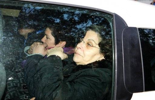 "Mafia boss Salvatore ""Toto"" Riina's widow Ninetta Bagarella and her daughter Maria Concetta leave Parma's hospital, where the autopsy of her husband took place, in Parma, northern Italy, Saturday, Nov. 18, 2017. Sicilian Cosa Nostra mafia 'boss of bosses,' 'Toto' Riina, one of Italy's most feared mobsters who was serving 26 life sentences, died Friday in the prison wing of the hospital, a day after his 87th birthday. (Sandro Capatti/ANSA via AP)"