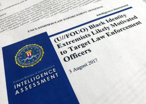 "In this Nov. 17, 2017, photo, the cover page of a FBI report on the rise of black ""extremists� is photographed in Washington. The report is stirring fears of a return to practices of the Civil Rights era, when the agency notoriously spied on activist groups without evidence they had broken any laws. Attorney General Jeff Sessions, a former Alabama senator whose career has been dogged by questions about race and his commitment to civil rights, did not ease lawmakers' concerns when he was unable to answer questions about the report or its origins during a congressional hearing on Nov. 14. (AP Photo/Jon Elswick)"
