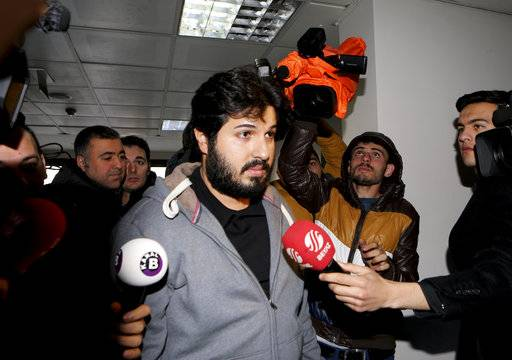 In this Tuesday, Dec. 17, 2013 photo, Turkish-Iranian businessman Reza Zarrab, who is charged currently in the U.S. for evading sanctions on Iran, is surrounded by the media members as he arrives at a courthouse in Istanbul, in a separate case against him. Turkish prosecutors on Saturday, Nov. 18, 2017, launched an investigation into two U.S. prosecutors involved in trying Zarrab, according to the country's official news agency. The case against gold trader Zarrab, 34, is built on work initially performed by Turkish investigators who targeted him in 2013 in a sweeping corruption scandal that led high up to Turkish government officials.(Depo Photos via AP)
