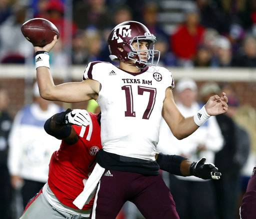 Texas A&M quarterback Nick Starkel (17) throws during the first half of an NCAA college football game against Mississippi in Oxford, Miss., Saturday, Nov. 18, 2017. (AP Photo/Rogelio V. Solis)