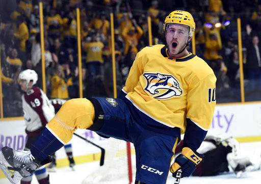 Nashville Predators center Colton Sissons celebrates after scoring a goal against the Colorado Avalanche during the second period of an NHL hockey game, Saturday, Nov. 18, 2017, in Nashville, Tenn. (AP Photo/Mark Zaleski)