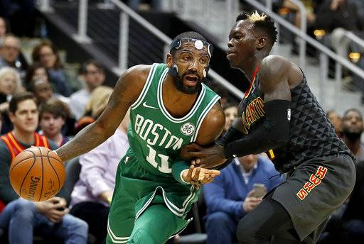 Boston Celtics' Kyrie Irving, left dribbles against Atlanta Hawks' Dennis Schroder, of Germany, in the second quarter of an NBA basketball game in Atlanta, Saturday, Nov. 18, 2017. Boston won 110-99. (AP Photo/David Goldman)