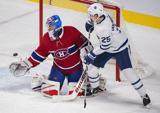Toronto Maples Leafs' James van Riemsdyk moves in on Montreal Canadiens goaltender Charlie Lindgren during the first period of an NHL hockey game in Montreal, Saturday, Nov. 18, 2017. (Graham Hughes/The Canadian Press via AP)