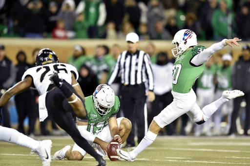 North Texas kicker Trevor Moore (30) kicks the game-winning field goal during the second half of an NCAA college football game against Army, Saturday, Nov. 18, 2017, in Denton, Texas. Moore kicked a 39-yard field goal with 5 seconds left to give North Texas a 52-49 victory. (Jeff Woo/The Denton Record-Chronicle via AP)
