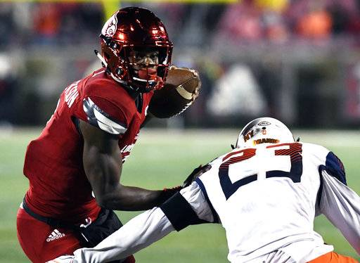 Louisville quarterback Lamar Jackson (8) avoids the rush by Syracuse linebacker Jonathan Thomas (23) during the second half of an NCAA college football game, Saturday, Nov. 18, 2017, in Louisville, Ky. Louisville won 56-10. (AP Photo/Timothy D. Easley)