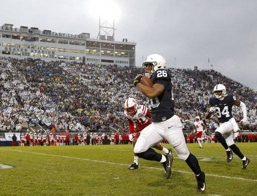 Penn State's Saquon Barkley (26) takes the ball 65 yards for a touchdown against Nebraska during the first half of an NCAA college football game in State College, Pa., Saturday, Nov. 18, 2017. (AP Photo/Chris Knight)